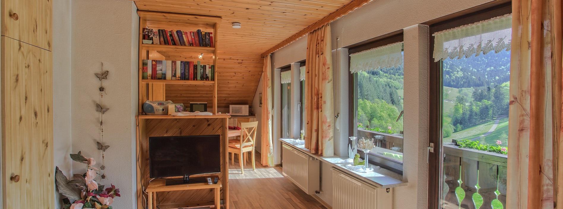 Wohnzimmer Ferienwohnung mit Waldblick